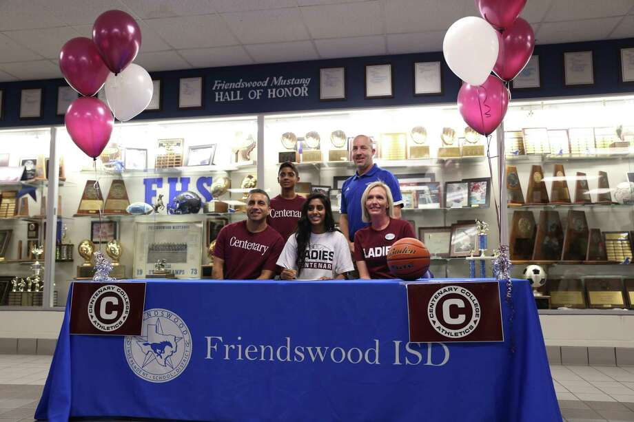 Priya Ponia of Friendswood signed a letter of intent to play basketball for Centenary College in Louisiana. Ponia is joined at the signing by her parents, Don-Yae and Anuj Ponia, her brother Anil Ponia and FHS Coach Daron Scott. Photo: Submitted Photo