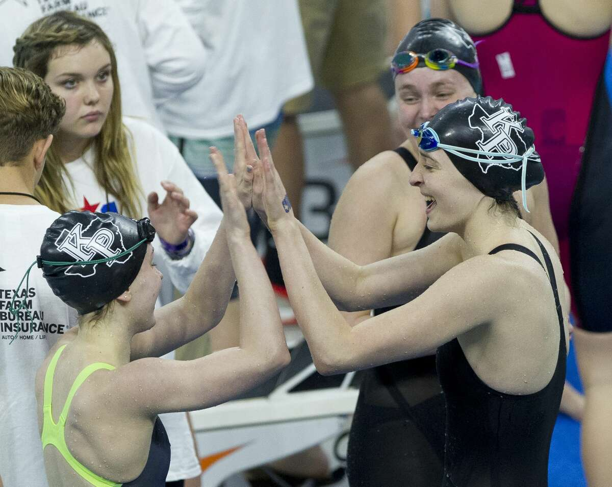 Kingwood Park swimmers react after winning the Class 5A girls 200-yard freestyle relay during the UIL State Swimming & Diving Championships at the Lee and Joe Jamail Texas Swim Center on Saturday, Feb. 17, 2018, in Austin.