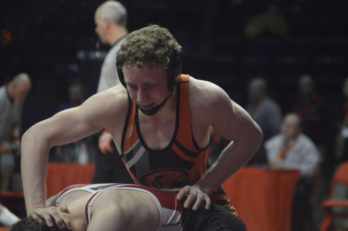 EHS sophomore Luke Odom puts the finishing touches on his win Saturday morning at the Class 3A state wrestling tournament.
