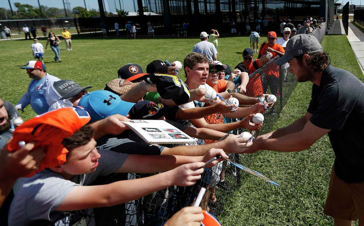Houston Astros RHP pitcher Gerrit Cole signs autographs for fans after practice during spring training at The Ballpark of the Palm Beaches, Saturday, Feb. 17, 2018, in West Palm Beach .