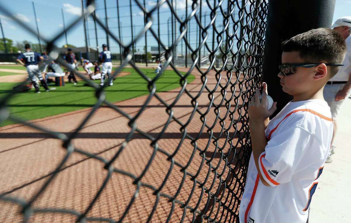 Jake Duffy, 9, of New York, wears a Jose Altuve jersey as he watched catchers work out during spring training at The Ballpark of the Palm Beaches, Saturday, Feb. 17, 2018, in West Palm Beach .