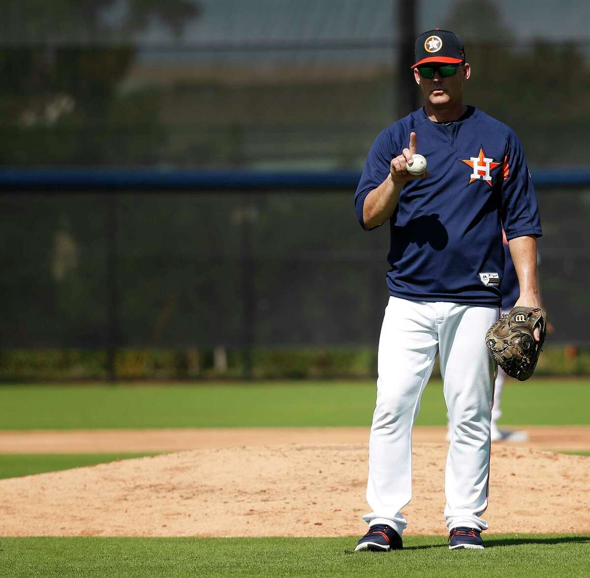 Houston Astros manager A.J. Hinch works with catchers during spring training at The Ballpark of the Palm Beaches, Saturday, Feb. 17, 2018, in West Palm Beach .
