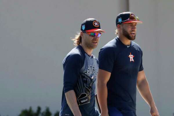 Houston Astros outfielders Josh Reddick and George Springer walks back to the clubhouse after a workout with other early arriving position players during spring training at The Ballpark of the Palm Beaches, Saturday, Feb. 17, 2018, in West Palm Beach .