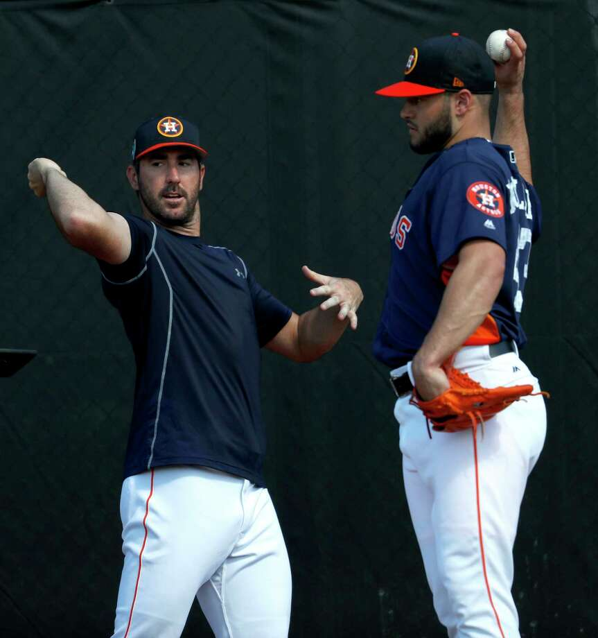 Houston Astros pitchers Justin Verlander (35) and Lance McCullers Jr. (43) work together as they consulted with Astros Director of Player Development, Pete Putila, in the bullpen during spring training at The Ballpark of the Palm Beaches, Saturday, Feb. 17, 2018, in West Palm Beach . Photo: Karen Warren, Houston Chronicle / © 2018 Houston Chronicle
