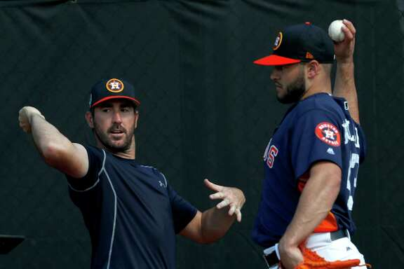 Houston Astros pitchers Justin Verlander (35) and Lance McCullers Jr. (43) work together as they consulted with Astros Director of Player Development, Pete Putila, in the bullpen during spring training at The Ballpark of the Palm Beaches, Saturday, Feb. 17, 2018, in West Palm Beach .