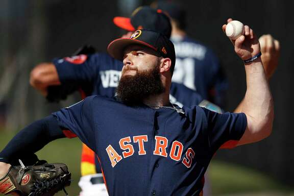 Houston Astros LHP pitcher Dallas Keuchel (60) throws in the bullpen during spring training at The Ballpark of the Palm Beaches, Saturday, Feb. 17, 2018, in West Palm Beach .