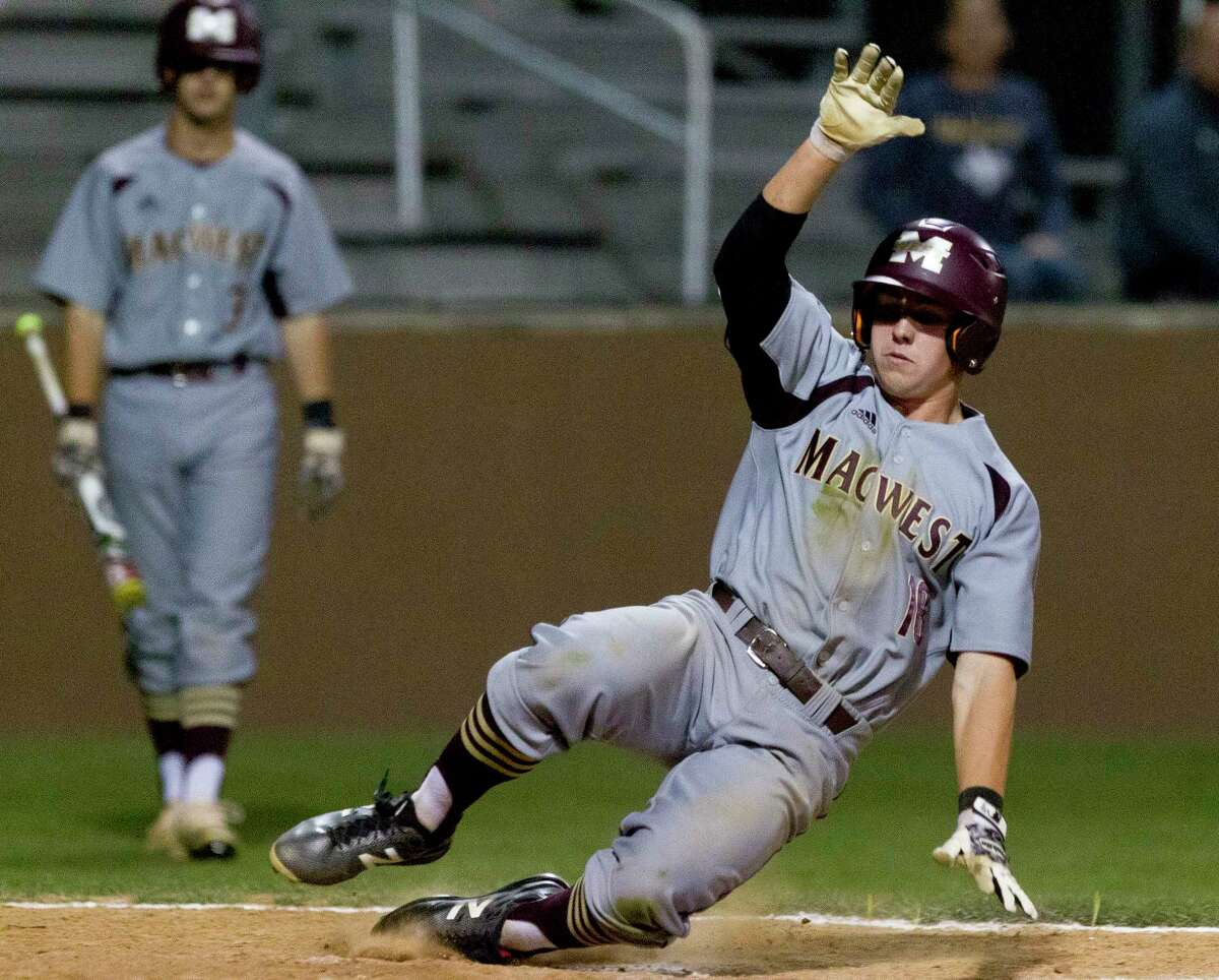 Zach Wall #18 of Magnolia West scores on a wild pitch from Willis pitcher Matthew Maddoux during the fourth inning of a District 21-5A high school baseball game Tuesday, March 21, 2017, in Willis. Willis defeated Magnolia West 7-6.