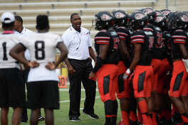 Port Arthur Memorial's head coach Kenny Harrison huddles with players before game start against Bay High School's during Saturday's match-up at the Lone Star Classic games. Photo taken Saturday, August 27, 2016 Kim Brent/The Enterprise