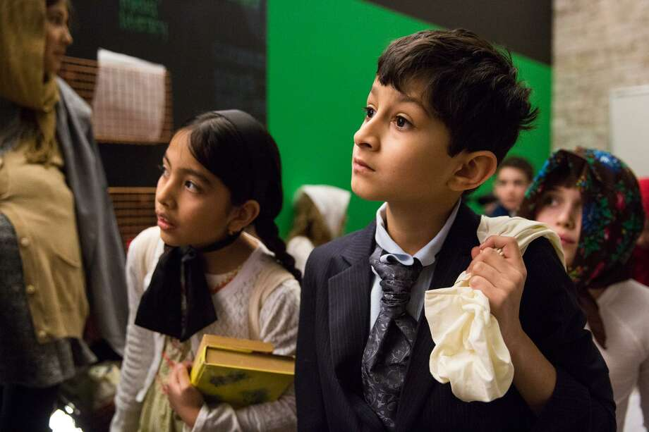 "Zayan Amin, acting as a Scandinavian Immigrant, looks on with other students from the ""waiting area"" during the Ellis Island Simulation at the Whitby School in Greenwich, Conn. on Thursday, February 8, 2018. During the simulation, students were assigned roles as immigrants from different countries with different financial and wellness backgrounds, while teachers acted as immgration and deportation officers, as well as nurses, to determine if the students were eligible to gain entry to the United States. Photo: Chris Palermo / For Hearst Connecticut Media / Greenwich Time Freelance"