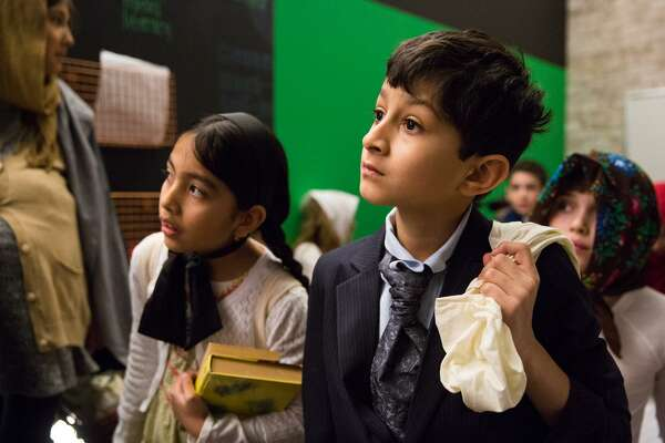 "Zayan Amin, acting as a Scandinavian Immigrant, looks on with other students from the ""waiting area"" during the Ellis Island Simulation at the Whitby School in Greenwich, Conn. on Thursday, February 8, 2018. During the simulation, students were assigned roles as immigrants from different countries with different financial and wellness backgrounds, while teachers acted as immgration and deportation officers, as well as nurses, to determine if the students were eligible to gain entry to the United States."