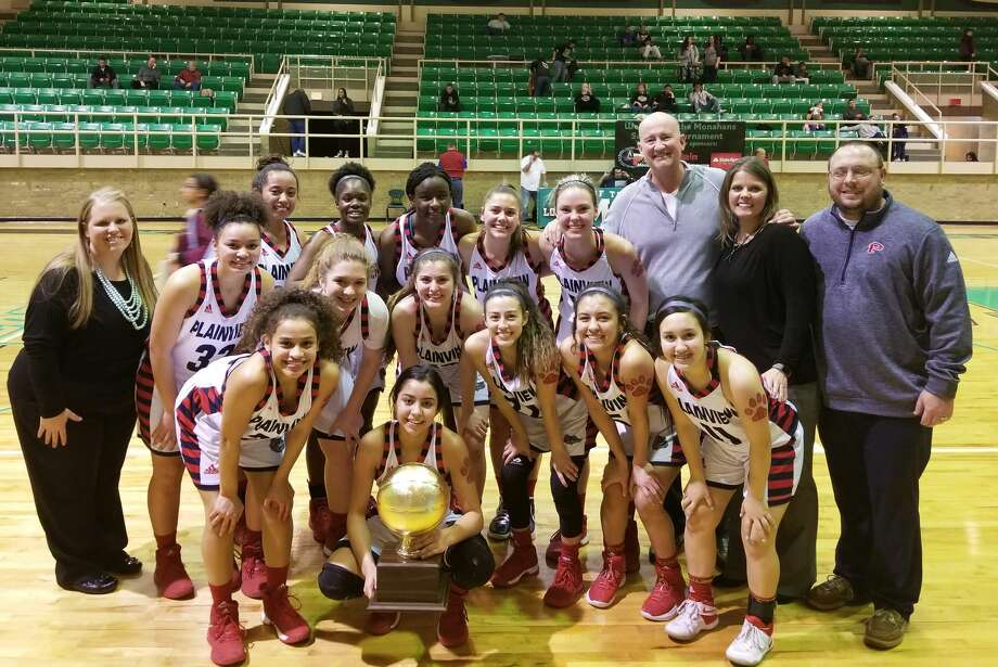 The Plainview girls' basketball team celebrates their area championship at Monahans High School Friday night. The Lady Bulldogs edged El Paso Andress, 44-42, to advance to the regional quarterfinals. Team members are front row, from left, Osen Ellis and Kristan Rincon (holding trophy). Second row, from left, assistant coach Allison Hodges, Taylor Stevenson, Kylie Bennett, Lauren Pritchard, Julissa Chavez, Aaliyah Rogers and Emily Sigala. Back row, from left, Oliva Shannon, Mahogany Nails, Jaclynn Black, Aspin Miller, Jesse Long, head coach Danny Wrenn, assistant coach Shelly Faught and assistant coach Kevin Faught. Photo: Carmen Ortega/Plainview Herald