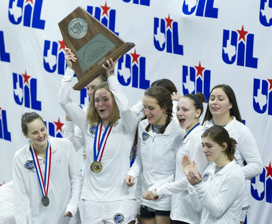 Kingwood Park girls swimmers celebrate after winning second place overall during the UIL State Swimming & Diving Championships at the Lee and Joe Jamail Texas Swim Center on Saturday, Feb. 17, 2018, in Austin. Photo: Jason Fochtman/Houston Chronicle