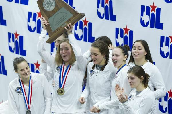 Kingwood Park girls swimmers celebrate after winning second place overall during the UIL State Swimming & Diving Championships at the Lee and Joe Jamail Texas Swim Center on Saturday, Feb. 17, 2018, in Austin.