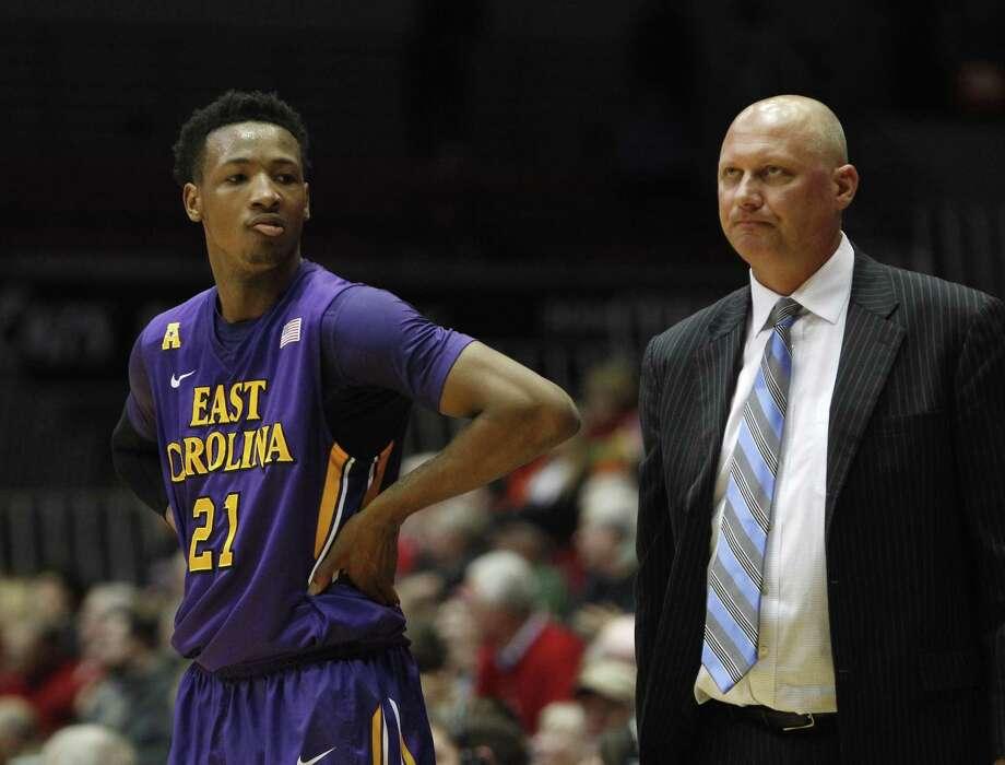 East Carolina head coach Jeff Lebo and guard B.J. Tyson, left, will host UConn on Sunday. Photo: Associated Press File Photo / FR170726 AP