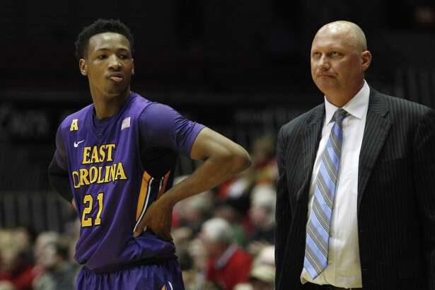 East Carolina head coach Jeff Lebo and guard B.J. Tyson, left, will host UConn on Sunday.