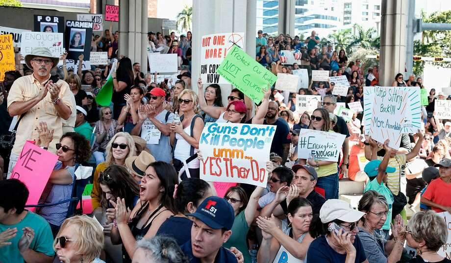 Protesters rally for more stringent gun controls in Fort Lauderdale, Fla. The demonstration followed the shooting attack Wednesday at a high school in Parkland that killed 17 people. Photo: RHONA WISE, AFP/Getty Images