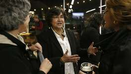 Texas Democratic gubernatorial candidate and former Dallas County Sheriff Lupe Valdez (center) talks with Eva Guzman (left) and Lupe Landeros during a meet and greet held Friday Jan. 12, 2018 at Alamo Beer.