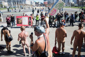 Participants protest on the steps of San Francisco's City Hall during the Nude Valentine's Day parade in San Francisco on February 17, 2018.