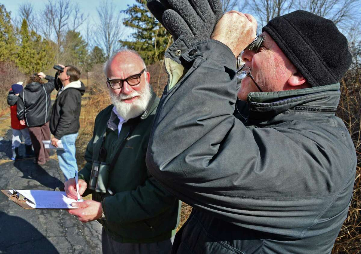 Craig Thompson of the Audubon Society of the Capital Region records sitings by Peter Horan, right, of Albany during the Great Backyard Bird Count at Five Rivers Environmental Education Center Saturday Feb. 17, 2018 in Delmar, NY. (John Carl D'Annibale/Times Union)