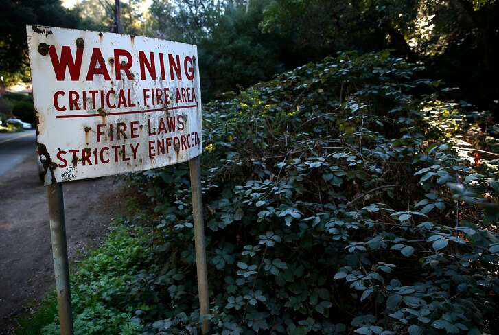 A sign on Thornhill Drive warns drivers of hazardous fire conditions in Oakland, Calif. on Friday, Feb. 16, 2018. Funds for the Oakland Fire Department's vegetation abatement program has already dried up raising concern in hillside neighborhoods.