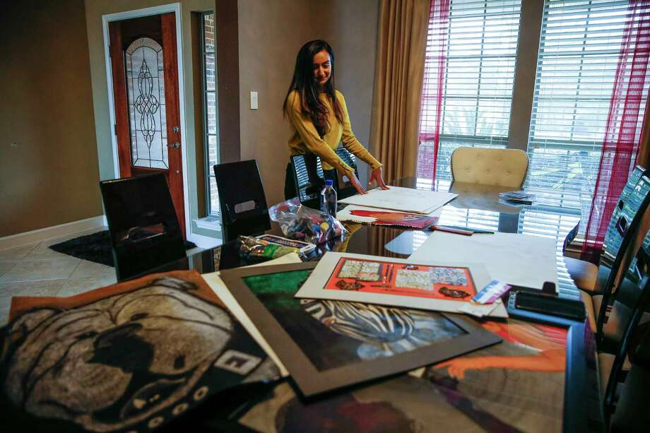 University of Houston senior Anmol Momin looks through some of her artwork Tuesday, Feb. 13, 2018 in Richmond. Momin has entered one piece, Soul Browser, in the Southwest Jubilee Arts Festival. The festival, which promotes and showcases the work of aspiring Ismaili Muslim artists, will take place at the Marriott Marquis Houston Feb. 24-25. (Michael Ciaglo / Houston Chronicle) Photo: Michael Ciaglo, Houston Chronicle / Michael Ciaglo
