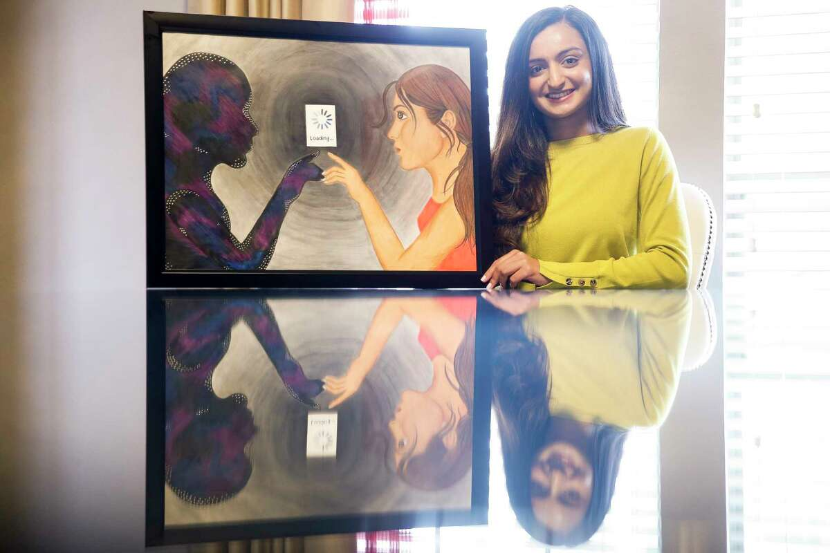 University of Houston senior Anmol Momin sits with her colored pencil art work, Soul Browser, Tuesday, Feb. 13, 2018 in Richmond, which she has entered in the Southwest Jubilee Arts Festival. The festival, which promotes and showcases the work of aspiring Ismaili Muslim artists, will take place at the Marriott Marquis Houston Feb. 24-25. (Michael Ciaglo / Houston Chronicle)
