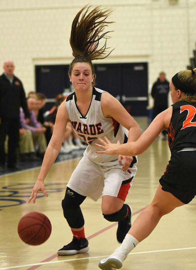 Fairfield Warde's Olivia Parisi, left, drives past Ridgefield's Caroline Curnal during Saturday's FCIAC girls basketball quarterfinal at the Zeoli Field House in Wilton. Photo: John Nash/Hearst Connecticut Media
