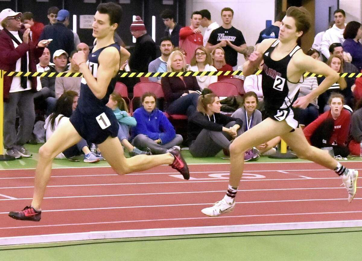 Staples' William Landowne stays ahead of Warde's Alex Mocarski in the 1,600-meter run at the 2018 FCIAC championships. Mocarski finished second in 4:22.88.