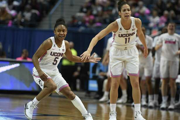 Crystal Dangerfield, left, Kia Nurse and the UConn women's basketball team hosts Temple on Sunday in Hartford.