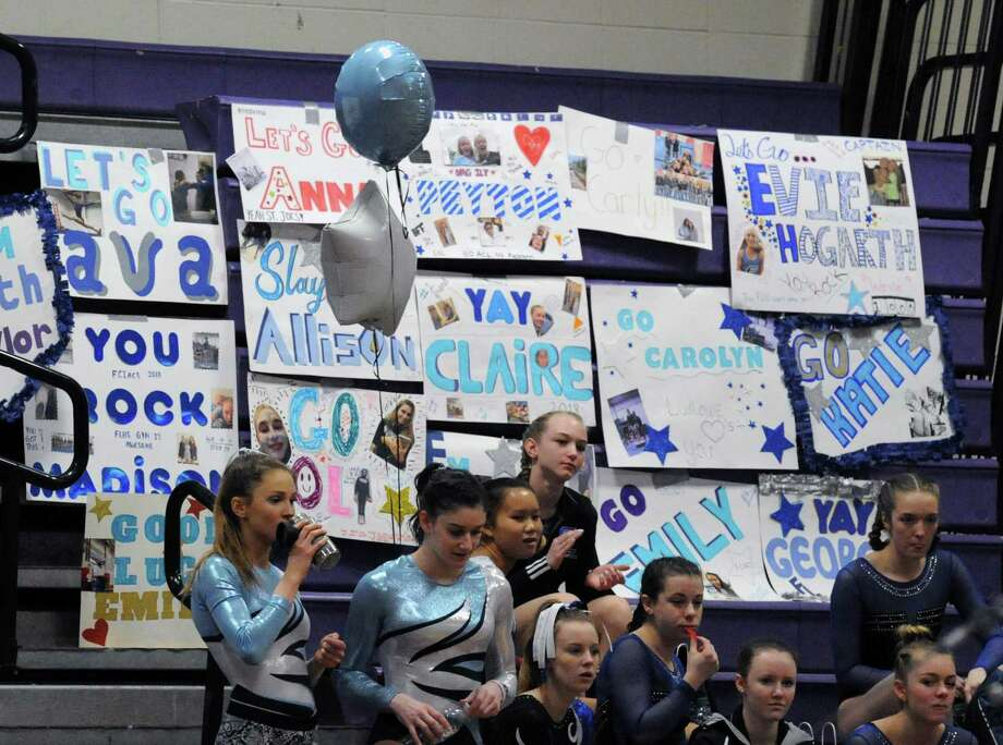 Signs and balloons show the support for the Ludlowe girls gymnastics team in the recent FCIAC championships. The Falcons finished third as a team. Photo: Bob Luckey Jr. / Hearst Connecticut Media / Greenwich Time