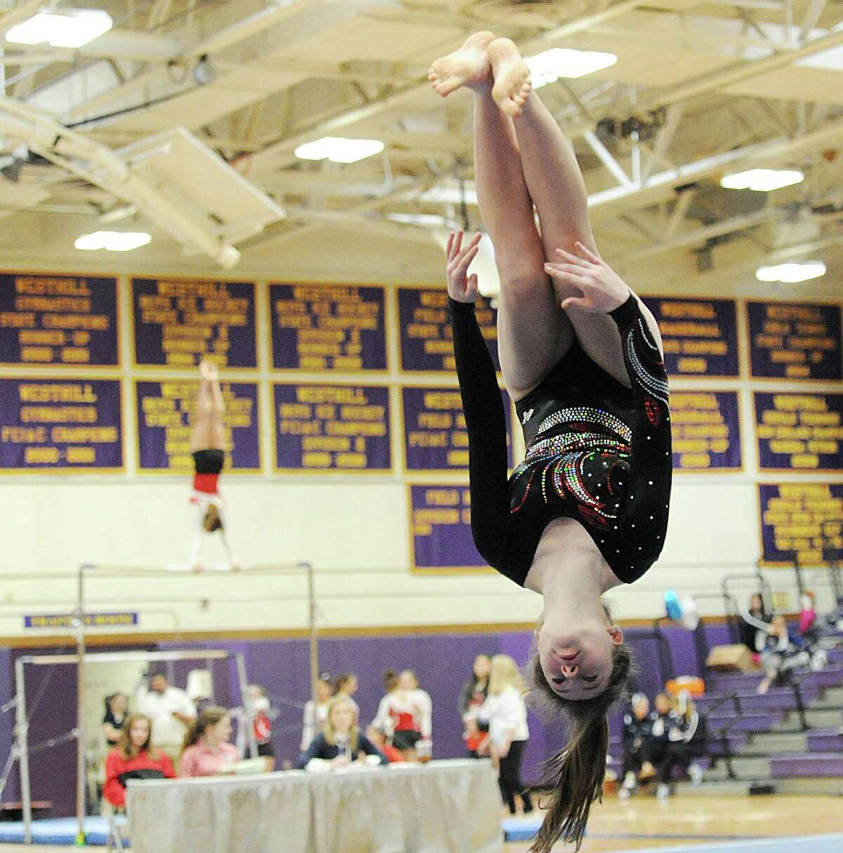 Warde's Judy Nemchek performs in the floor exercise during the FCIAC gymnastics championships on February 10.