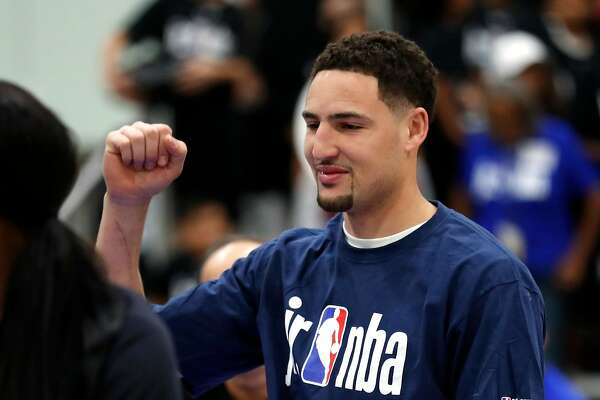 Golden State Warriors' Klay Thompson takes part in Jr. NBA Day at LA Convention Center in Los Angeles, Calif., on Friday, February 16, 2018.