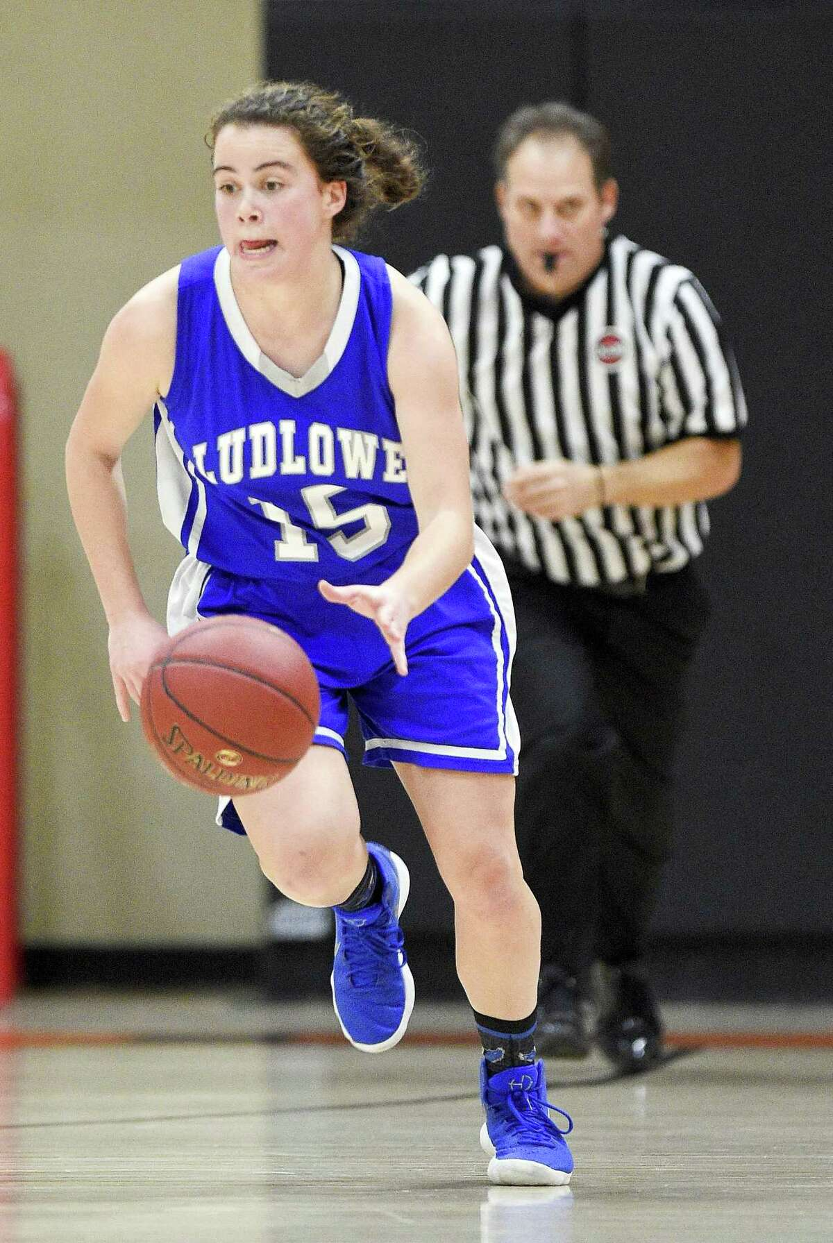 Fairfield Ludlowe's Bridget Paulmann (15) drive up court against Stamford during a girls varsity basketball game at Stamford High School in Stamford, Conn. on Friday, Dec. 22, 2017. Stamford defeated Fairfield Ludlowe 38-33.