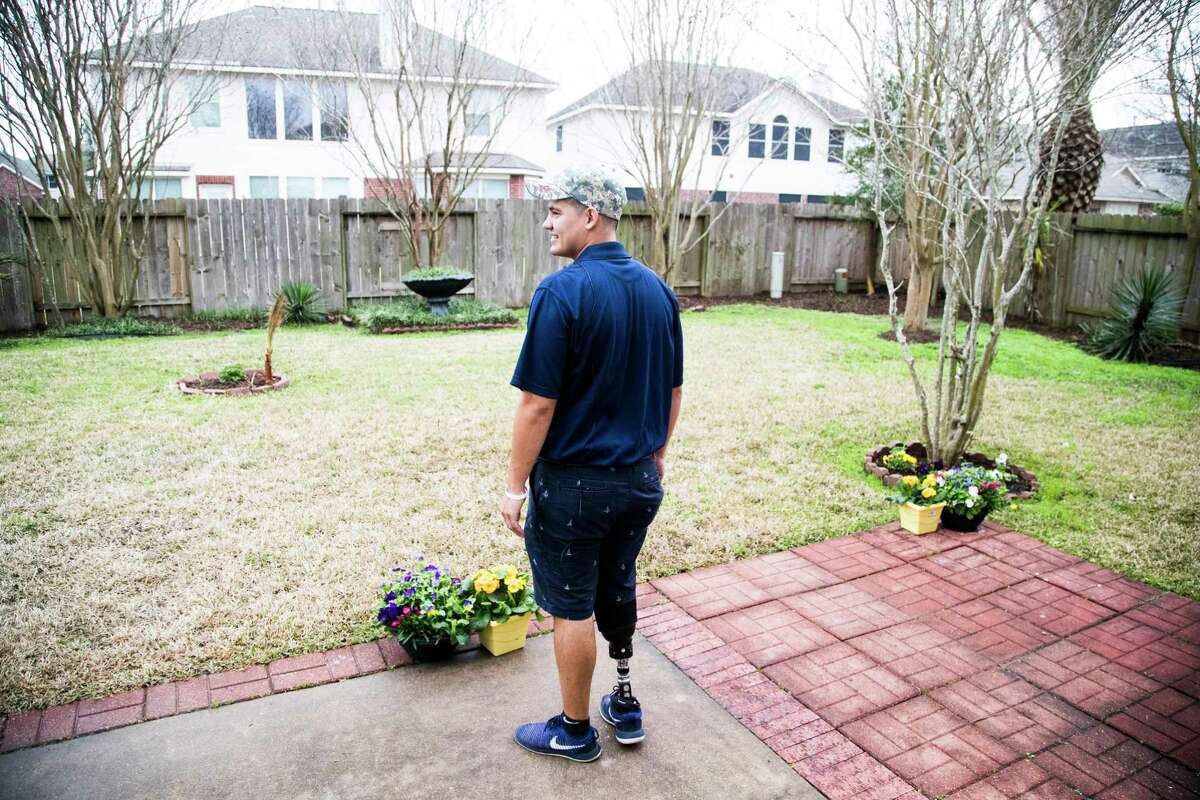Michael Villagran, an Army veteran and single father, who lost his leg in combat takes a look at the backyard of his new home in awe.