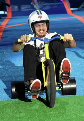 NBA player Klay Thompson competes in abike race onstage at the Nickelodeon Kids' Choice Sports Awards 2015 at UCLA's Pauley Pavilion on July 16, 2015 in Westwood, California.