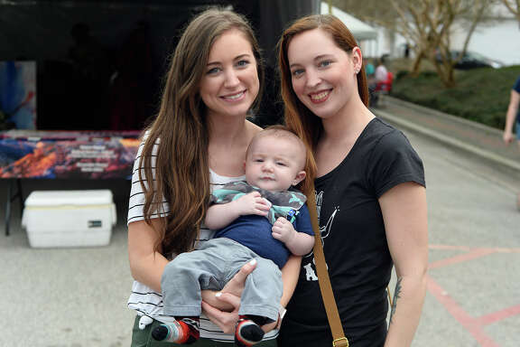 Emily Sanders and Whittney English with baby Aubrey English at the New Orleans on Orleans festival on Saturday.  Photo taken Saturday 2/17/18 Ryan Pelham/The Enterprise