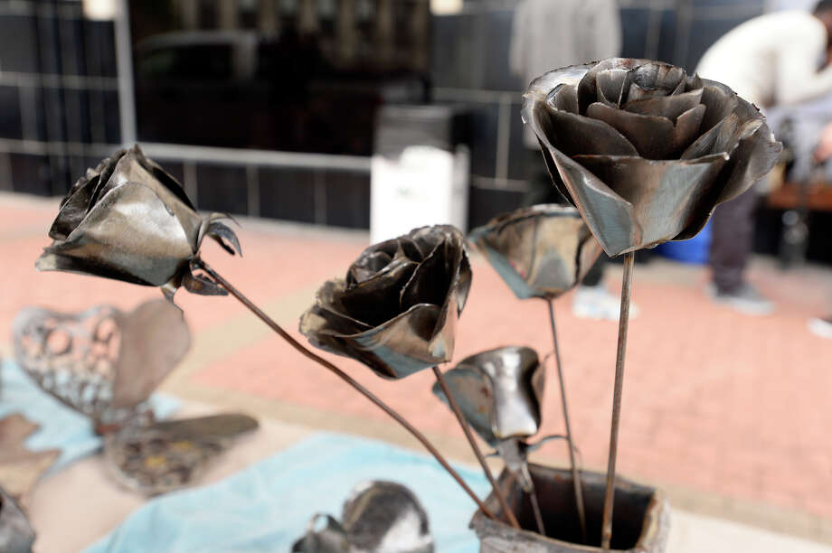 Sculpted metal roses on display at Tindall Welds' booth at the New Orleans on Orleans festival on Saturday.  Photo taken Saturday 2/17/18 Ryan Pelham/The Enterprise Photo: Ryan Pelham / ©2017 The Beaumont Enterprise/Ryan Pelham