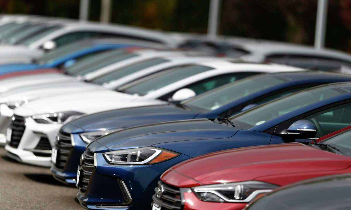 In this Friday, Oct. 6, 2017, a long line of unsold 2018 Sonatas sits outside a Hyundai dealership in the south Denver suburb of Littleton, Colo. Even car buyers who hate to haggle can get a good deal on their next car with the help of online shopping tools and non-confrontational negotiating tactics. (AP Photo/David Zalubowski)