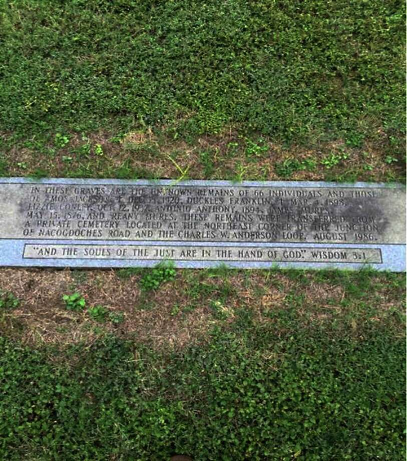 "This is a marker at Holy Cross Cemetery, 17501 Nacogdoches Road, that notes the location of remains that were reinterred from an African American cemetery once located at ""the northeast corner of the junction of Nacogdoches Road and the Charles W. Anderson Loop (1604)"" in August 1986. Photo: Courtesy /"