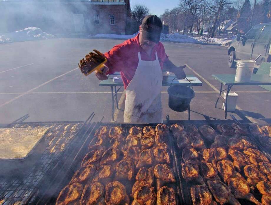 Times Union Staff photo by Skip Dickstein      Harry Parkington of Brooks Barbecue bastes his chicken in the church parking lot at the benefit barby at Bethany Reformed Church in Albany, New York February 18, 2004.  The weather cooperated with the barbecue. Photo: SKIP DICKSTEIN / ALBANY TIMES UNION