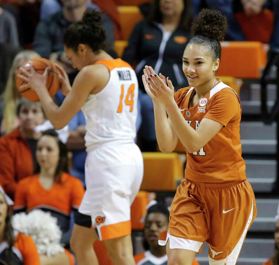 Brooke McCarty (11) of Texas celebrates in front of Oklahoma State's Braxtin Miller (14) after a Texas basket during an NCAA college basketball game at Gallagher-Iba Arena in Stillwater, Saturday, Feb. 17, 2018. (Bryan Terry/The Oklahoman via AP) Photo: Associated Press / BRYAN TERRY/THE OKLAHOMAN