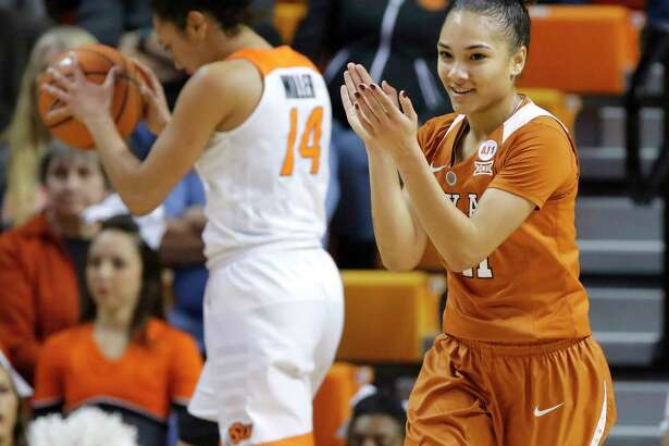 Brooke McCarty (11) of Texas celebrates in front of Oklahoma State's Braxtin Miller (14) after a Texas basket during an NCAA college basketball game at Gallagher-Iba Arena in Stillwater, Saturday, Feb. 17, 2018. (Bryan Terry/The Oklahoman via AP)