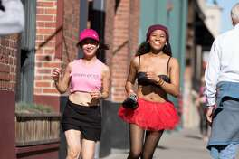 Joanne Montemayor and Josbeth Banaag of San Francisco finish the Cupid's Undie Run around AT&T park in San Francisco on February 17, 2018.