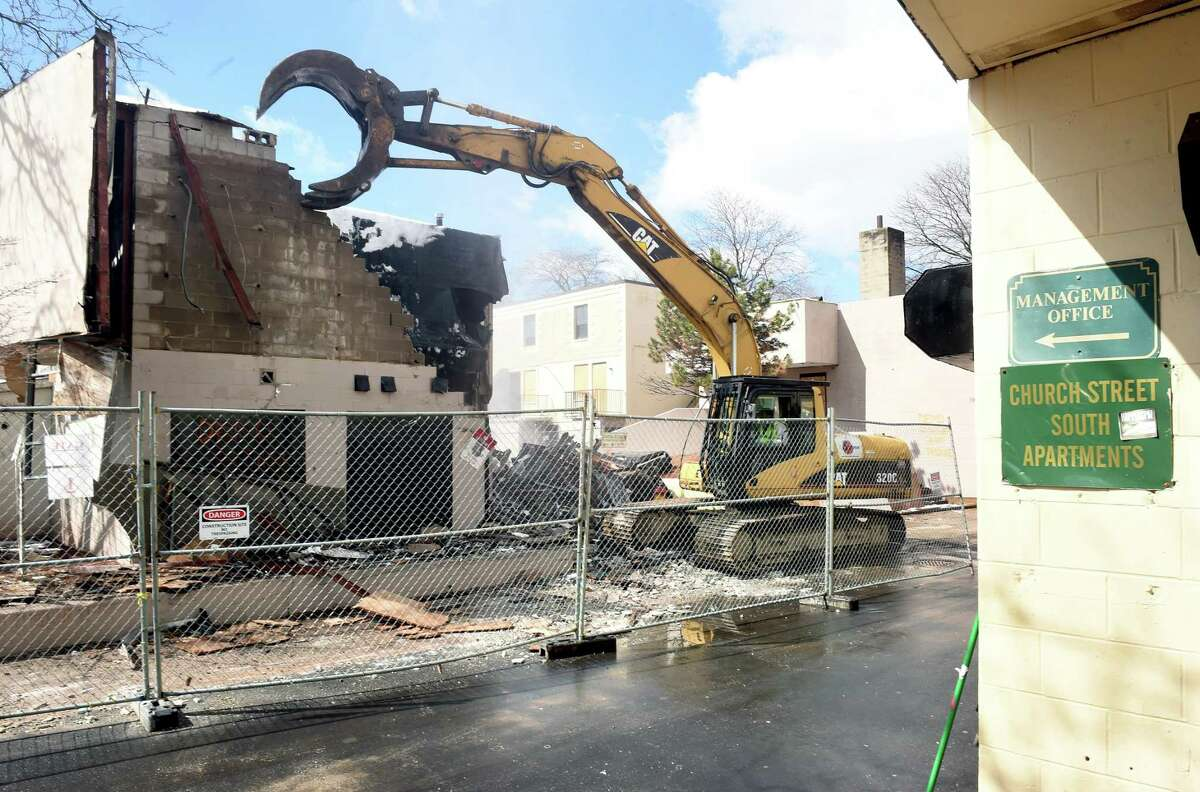 (Arnold Gold-New Haven Register) A former laundromat is demolished at the Church Street South Apartments complex in New Haven on 3/21/2016.