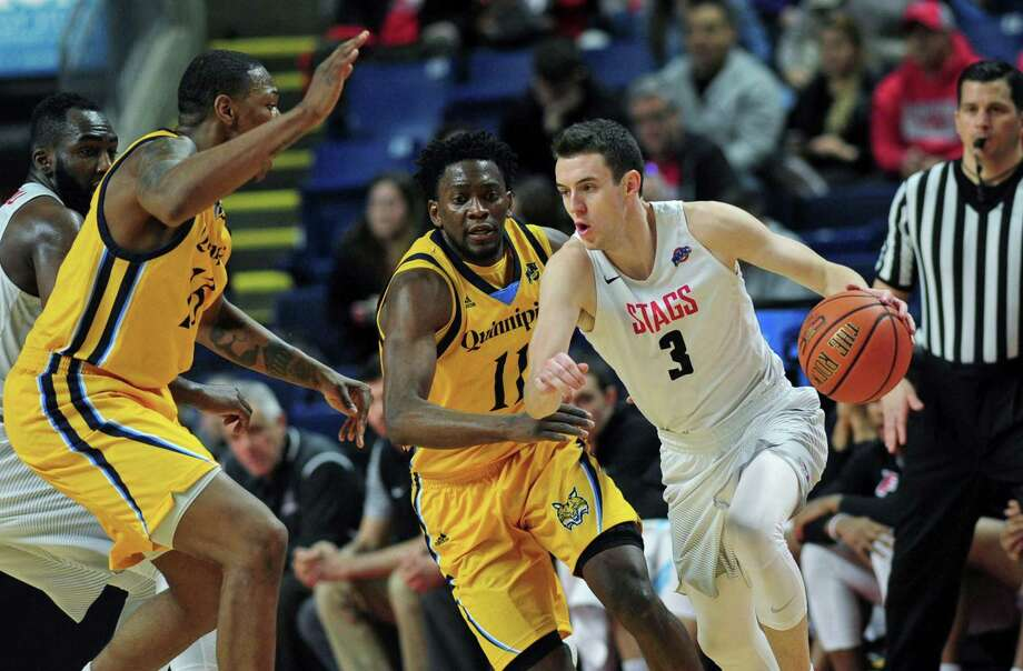 Fairfield University's Tyler Nelson gets the ball past Quinnipiac's Alain Chigha in their MAAC Men's Basketball game Friday, February 17, 2018, at Webster Arena in Fairfield, Conn. Photo: Erik Trautmann / Hearst Connecticut Media / Norwalk Hour