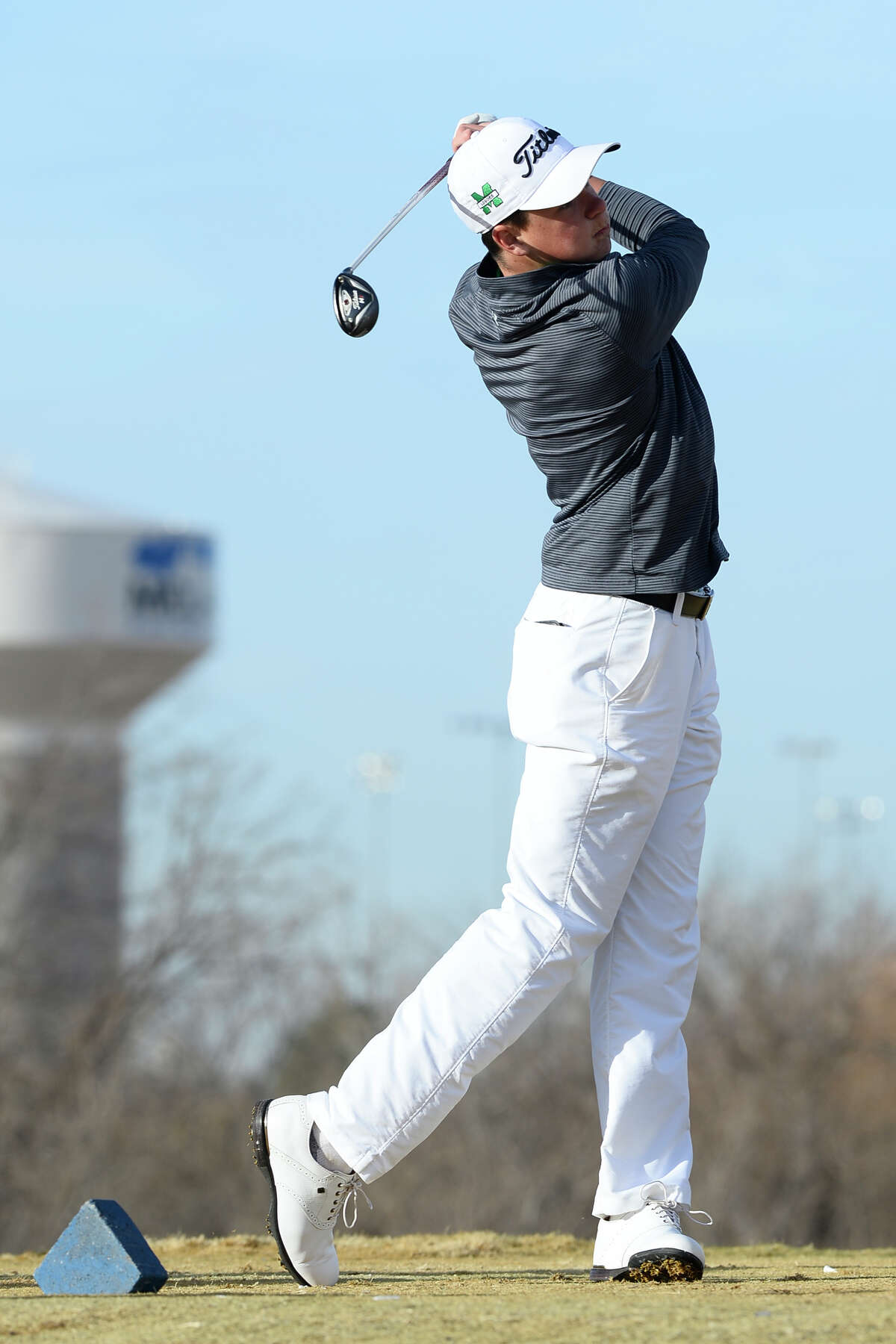 Monahans' Bond Heflin tees off on hole two of the Roadrunner Course during the Boys Tall City Invitational Feb. 17, 2018, at Hogan Park Golf Course. James Durbin/Reporter-Telegram