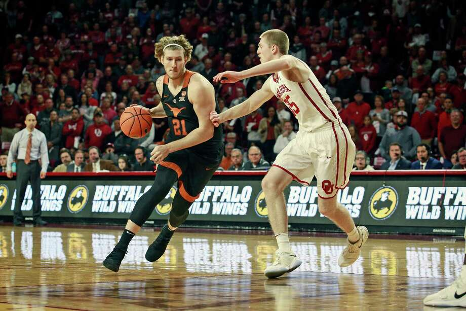 NORMAN, OK - FEBRUARY 17: Dylan Osetkowski #21 of the Texas Longhorns drives inside on Brady Manek #35 of the Oklahoma Sooners at Lloyd Noble Center on February 17, 2018 in Norman, Oklahoma. The Longhorns defeated the Sooners 77-66. Photo: Brett Deering, Getty Images / 2018 Getty Images