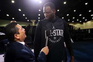 Golden State Warriors' Draymond Green is asked  a question by Jimmy Kimmel Live's Guillermo Rodriguez during NBA All Star Media Day at LA Convention Center in Los Angeles, Calif., on Saturday, February 17, 2018.