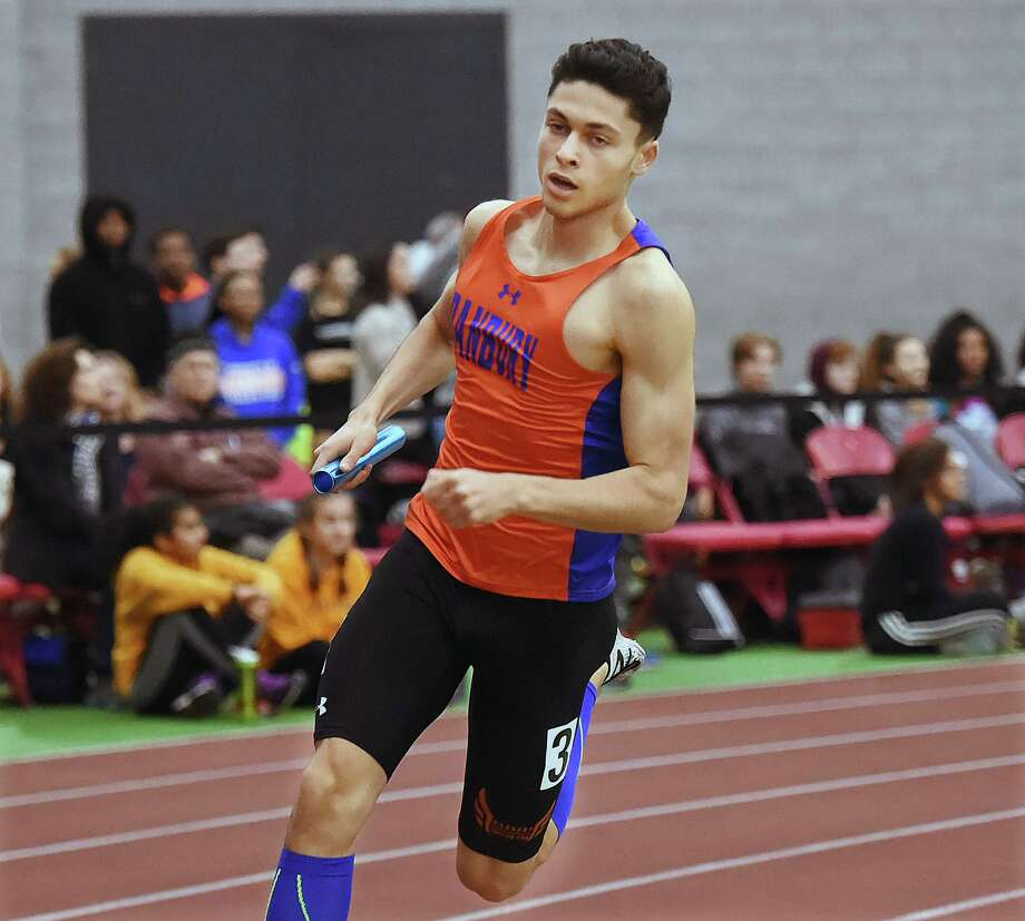 Danbury junior Malcolm Going runs the final leg of the 4x400 meter relay with teammates Sean-Michael Parkinson, Glenroy Ford and Malachius Lorick in an official time of 3:28.55 at the CIAC Boys Indoor Track & Field State Open, Saturday, Feb. 17, 2018, at Floyd Little Athletic Center at Hillhouse High School in New Haven. Malcolm also won the 600 meter run in 1:20.40. Photo: Catherine Avalone, Hearst Connecticut Media / New Haven Register