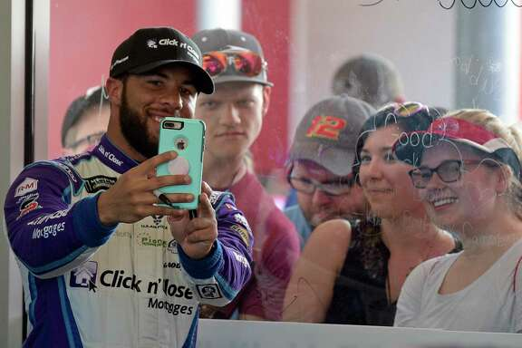 Darrell Wallace Jr., the first black driver to start the Daytona 500 since 1969, draws a crowd as he mingles with fans during Saturday's Daytona 500 practice.